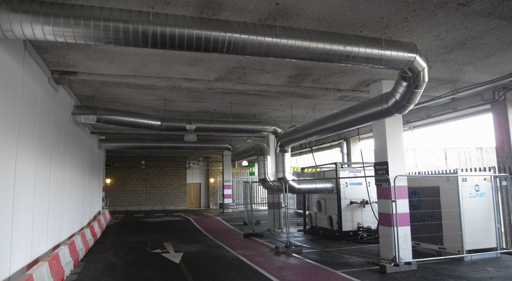 The temporary HVAC system installed at the Olympic Excel Fleet Depot. An ACS 160.120 climate control air handler was used with a 110kw chiller. External ductwork was made in solid Spiral with a fabric air sock system fitted internally.
